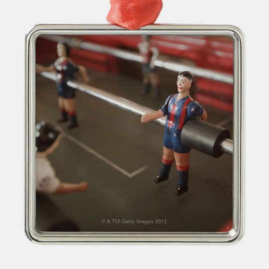 Old table football player metal ornament