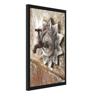 Old tap outside canvas print