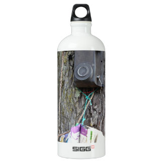 Old telephone and phone book on tree water bottle