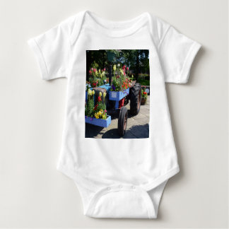Old Tractor Floral Display Baby Bodysuit