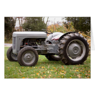 Old tractor in fall greeting card