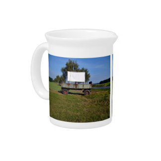 Old Tractor Trailer on a Green Field Drink Pitcher