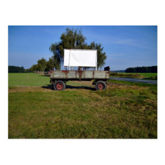Old Tractor Trailer on a Green Field Postcard
