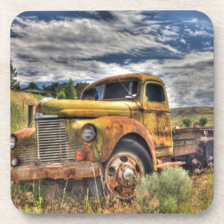 Old truck abandoned in field coasters