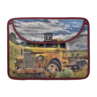Old truck abandoned in field MacBook pro sleeve