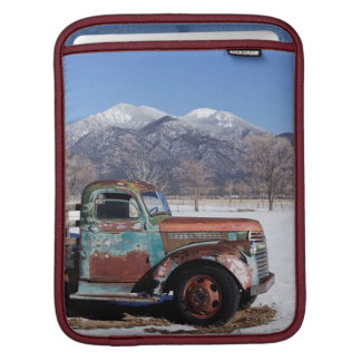 Old truck sitting in the field iPad sleeve