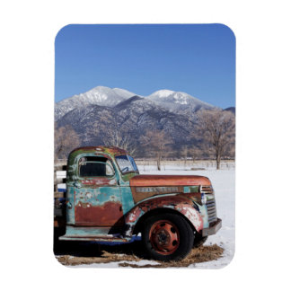 Old truck sitting in the field magnet