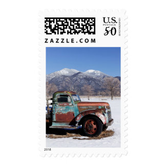 Old truck sitting in the field postage
