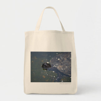 old turtle swimming tote bags