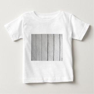 Old varnished grey wooden barn door texture baby T-Shirt