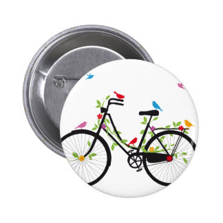Old vintage bicycle with flowers and birds pinback button