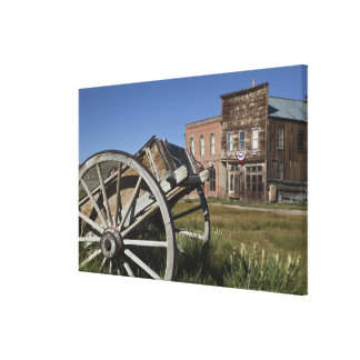 Old wagon and store fronts in Bodie State Canvas Print