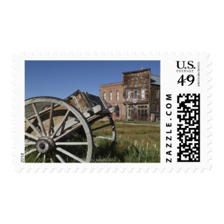 Old wagon and store fronts in Bodie State Postage