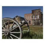 Old wagon and store fronts in Bodie State Poster