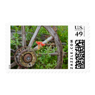 Old wagon wheel in historic old gold town 2 postage