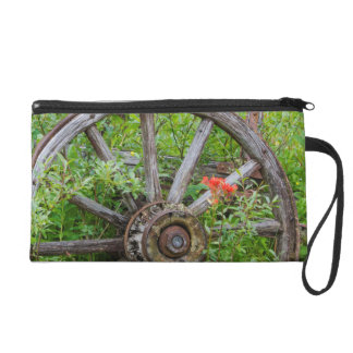 Old wagon wheel in historic old gold town 3 wristlet