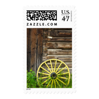 Old wagon wheel in historic old gold town postage