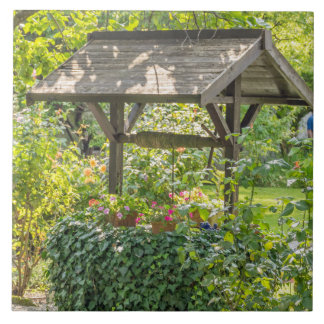 Old well in a garden ceramic photo tile