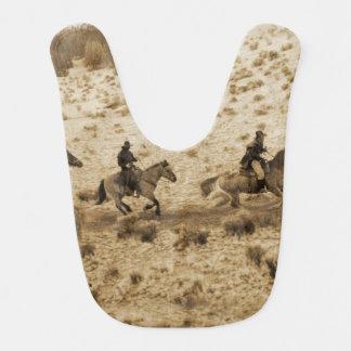 Old West Cowboys Riding Baby Bib