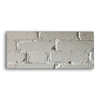 Old white brick wall with nooks and crannies envelope