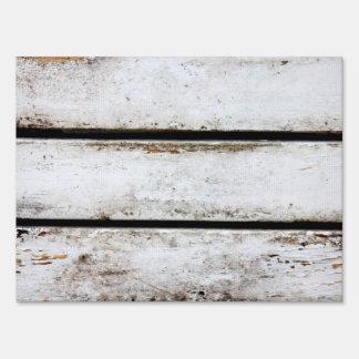Old white wood yard sign