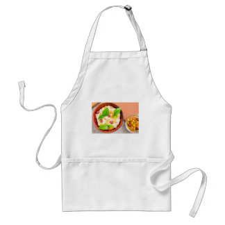 Old wooden bowl of healthy oatmeal with berries adult apron