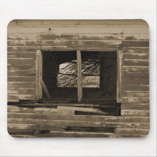 Old wooden building broken out window sepia tone mouse pad