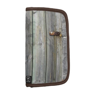 Old Wooden Door In A Stone Wall Organizer