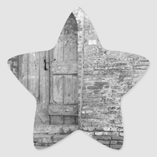 Old wooden door in old brick wall. Black and white Star Sticker