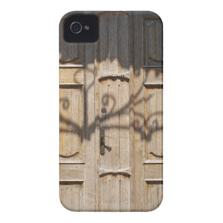 Old wooden door of unpainted wood with curly strip iPhone 4 Case-Mate cases
