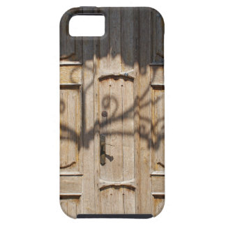 Old wooden door of unpainted wood with curly strip iPhone 5 cases
