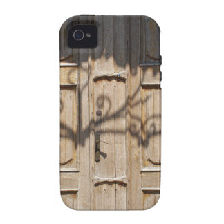 Old wooden door of unpainted wood with curly strip iPhone 4 covers