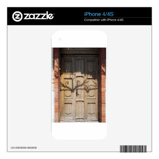Old wooden door of unpainted wood with curly strip skin for the iPhone 4