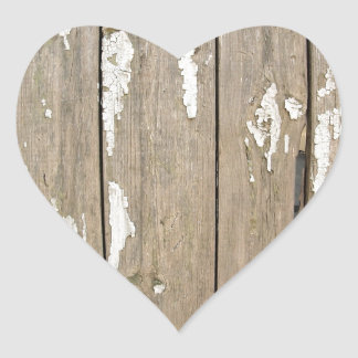 Old wooden fence with exfoliated paint heart sticker