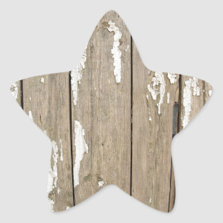 Old wooden fence with exfoliated paint star sticker