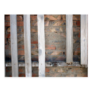 Old wooden, unpainted and rotten boards postcard