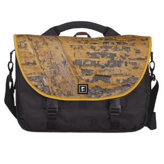 Old yellow wall laptop bag