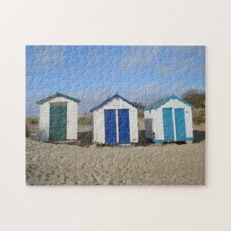 oldbeach huts and blue sky English seaside photo Jigsaw Puzzle