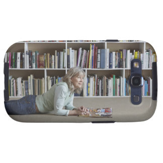 Older woman reading by bookshelves samsung galaxy s3 covers
