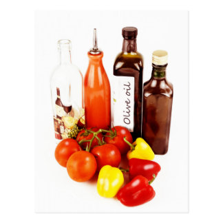 Olive evoo oil bottles and veggies post card