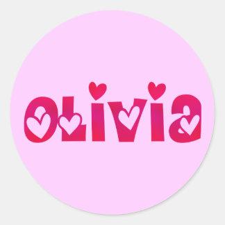 Olivia en corazones pegatina redonda