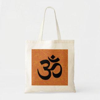 Om in a sea of orange waves tote bags
