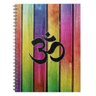 Om sign on multicolor wood spiral notebook
