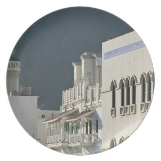 Oman, Muscat, Mutrah. Mutrah Corniche Mosque and Dinner Plates