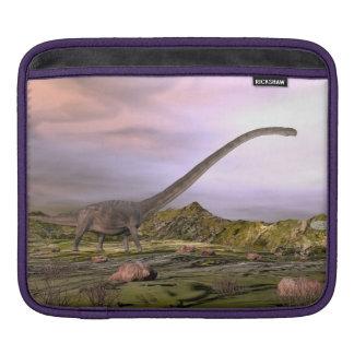 Omeisaurus walking in the desert by sunset iPad sleeve