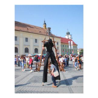 On stilts in a festival flyer