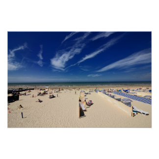 On the beach, blue sky poster