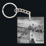 "on the Charles Bridge under a stormy sky in Prague Keychain<br><div class=""desc"">A monochrome photograph taken on a stormy day on the Charles Bridge in Prague, Czech Republic is featured on this souvenir keyring. The keyrings are made of ultra-durable acrylic and are UV resistant and waterproof. The text is customisable or removable and you can choose from a range of styles and...</div>"