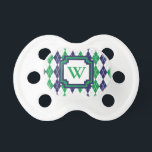 "On the Green Argyle Pacifier<br><div class=""desc"">Argyle goes 8-bit with this classic navy blue,  kelly green,  and white color scheme with a light gray contrast stitch creating a perfect pattern for the golf course. Customize the monogram with the appropriate initial for a personalized touch.</div>"
