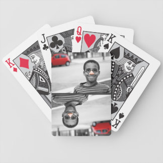 on the street clown bicycle playing cards